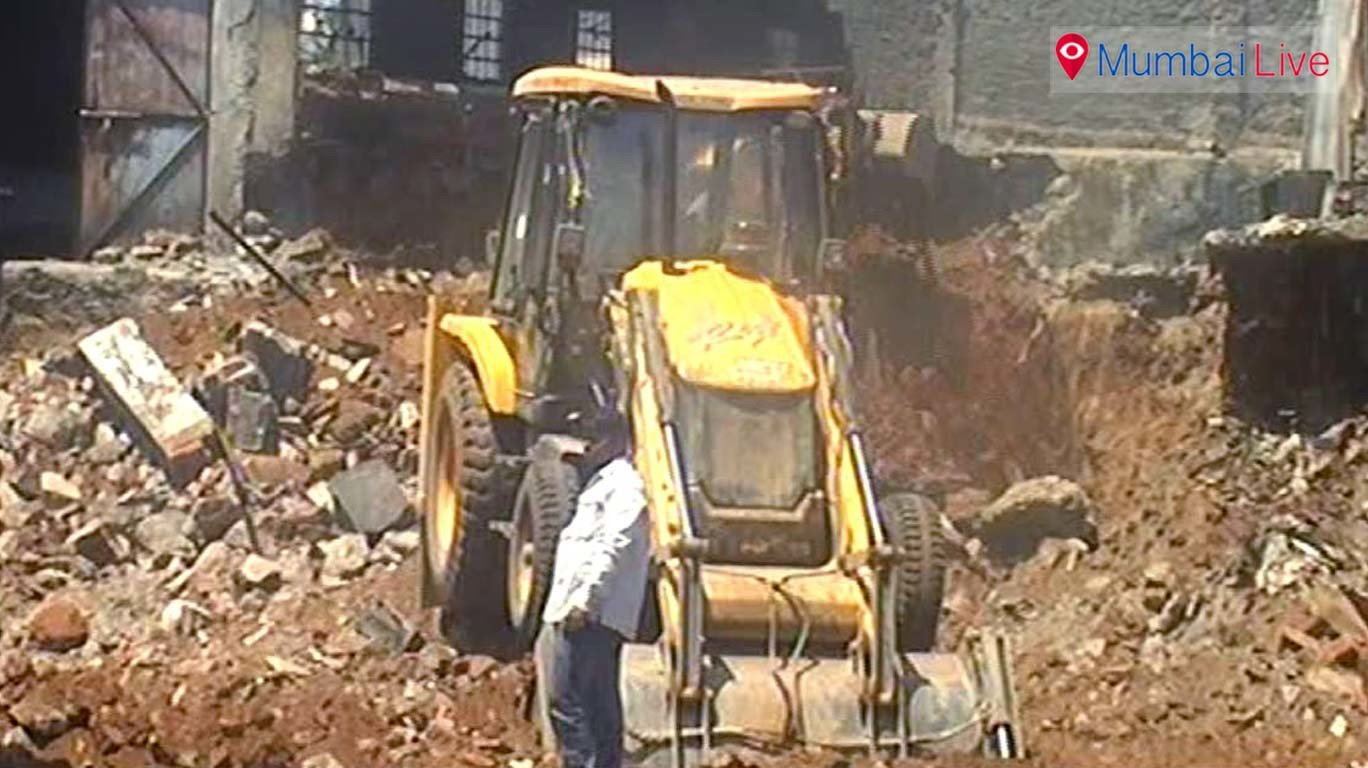 Forest dept officials demolish illegal residential buldings