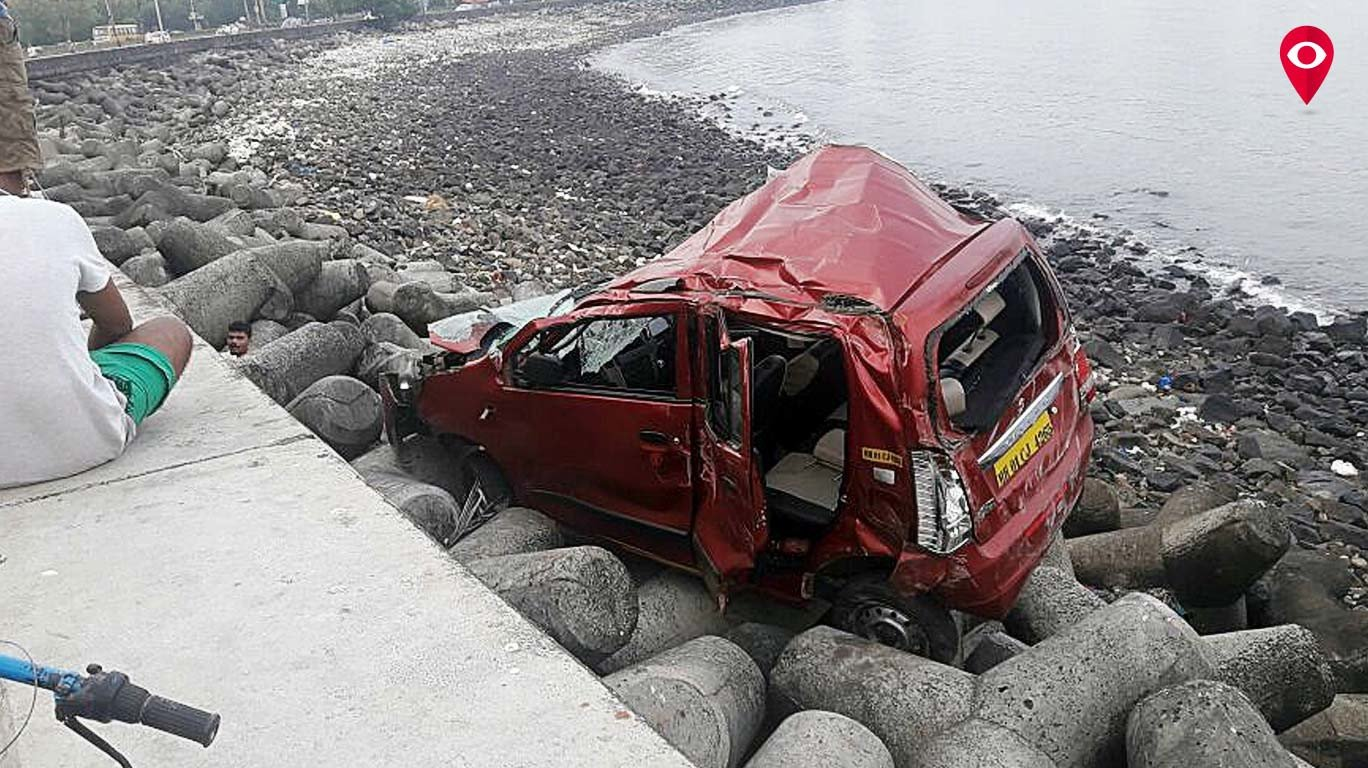 OLA driver naps behind the wheel, car breaks barricade and lands near tetrapods