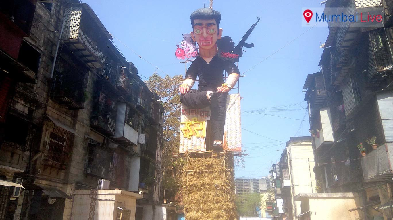 BDD chawl residents' burn effigy against corruption on Holika Dahan