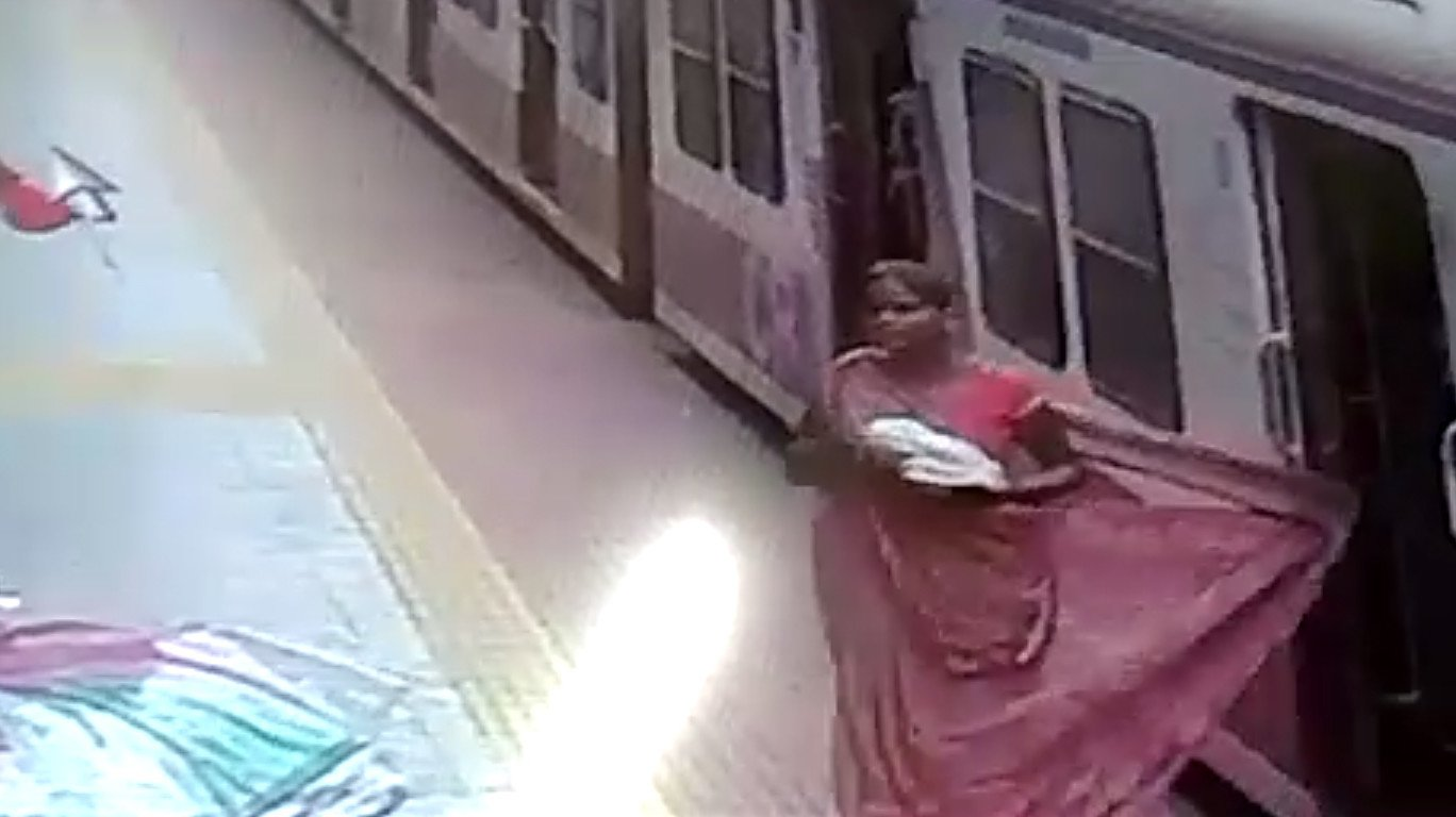 RPF officer saves a woman from falling on railway tracks