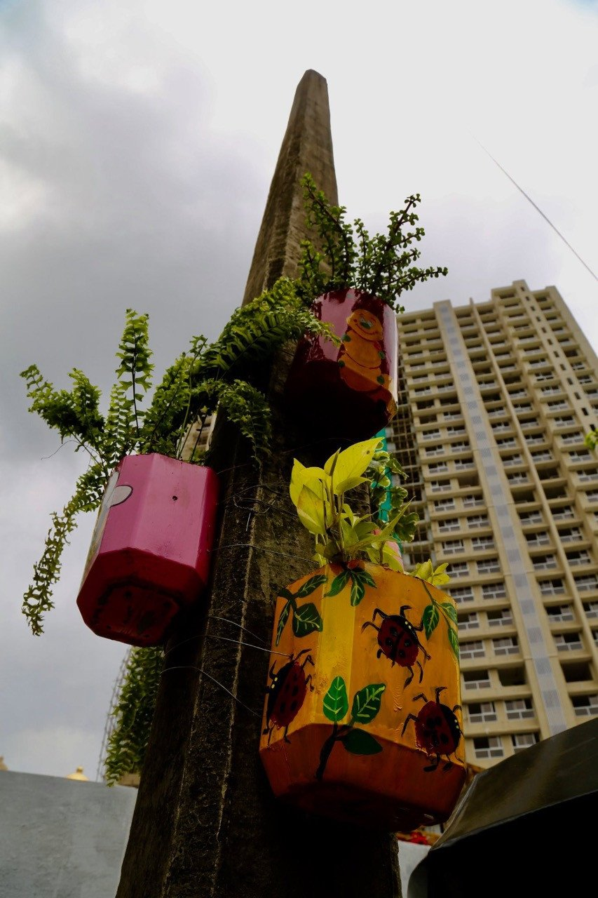 When Waste Cans Turn Into Canvases and Creates A Vertical Garden