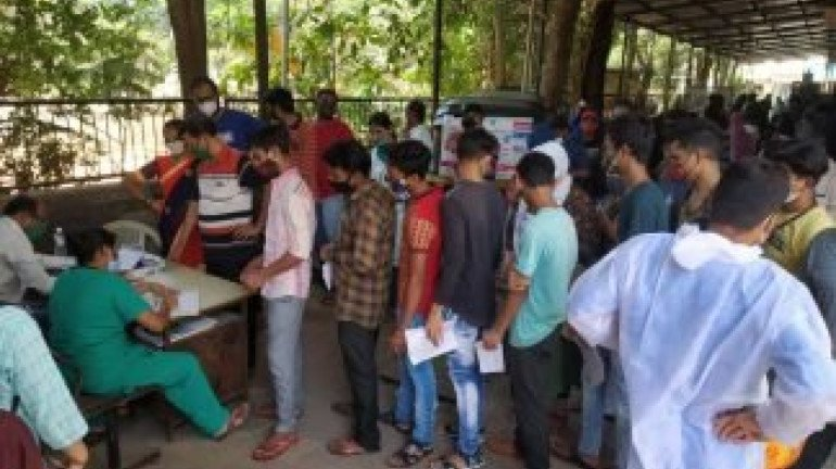 People queue outside Dombivli's Shastri Nagar Hospital for the admission of COVID-19 patients