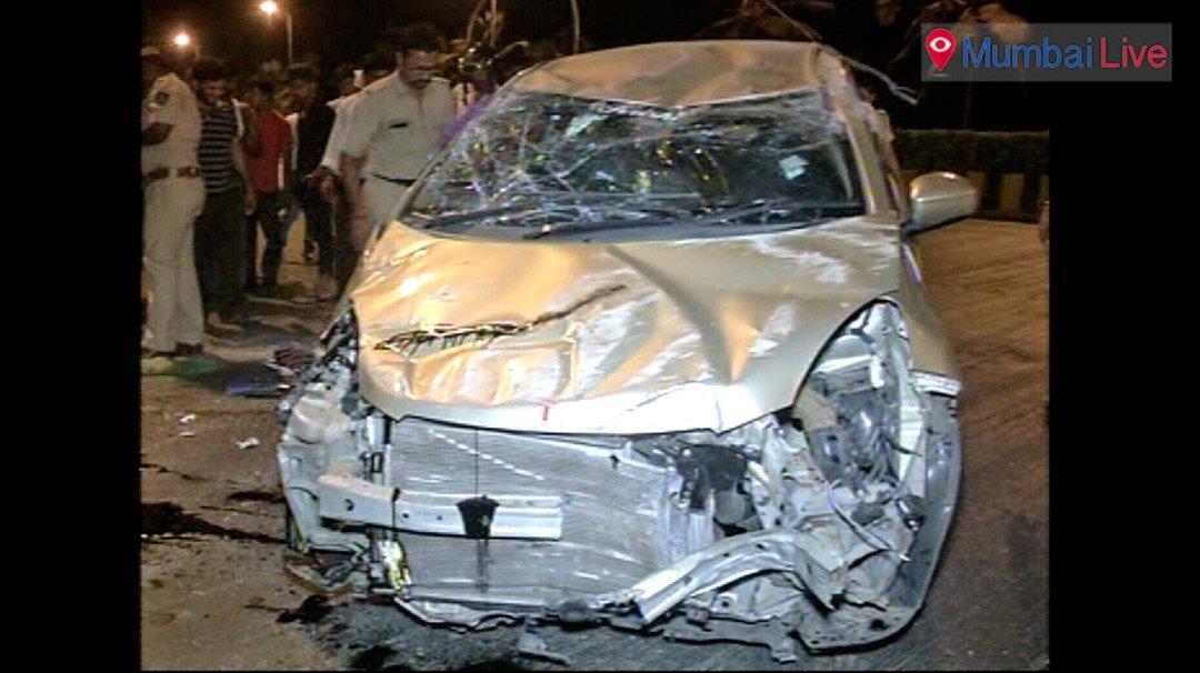 Car rams into road divider, 4 injured