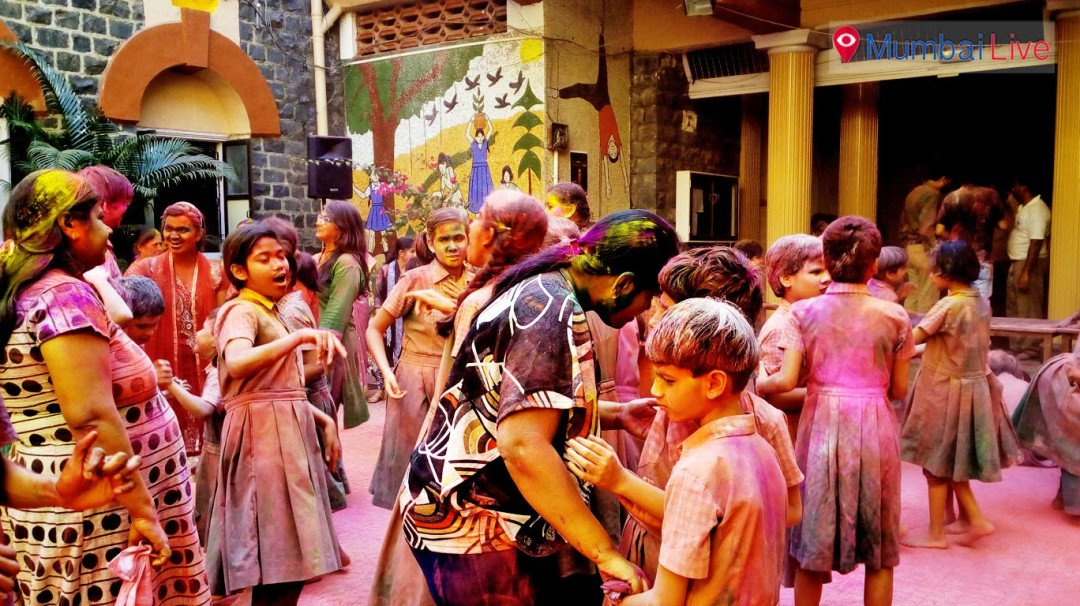 Save water: Blind children play Holi with dry colours