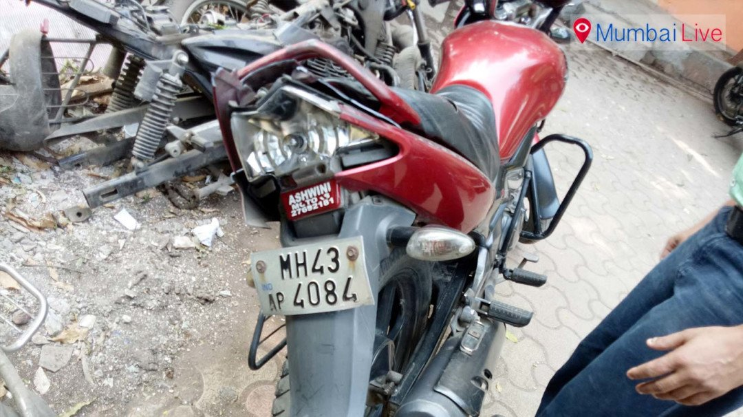 Motorcycle rammed into container