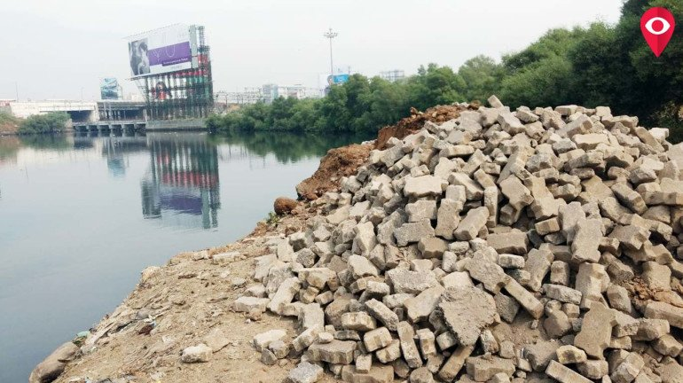 Corporator Milind Vaidya irked by BMC corporator for dumping debris in Mithi river