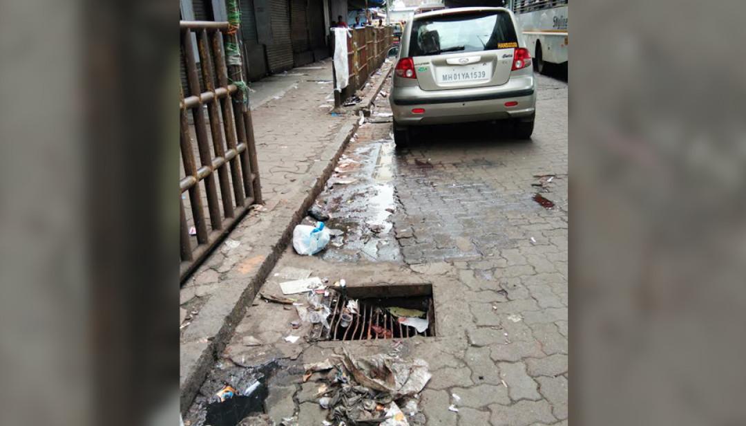 रस्त्यावरील गटाराच्या झाकणाची दुरवस्था