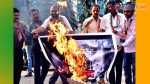 Congress workers burn Godse play poster