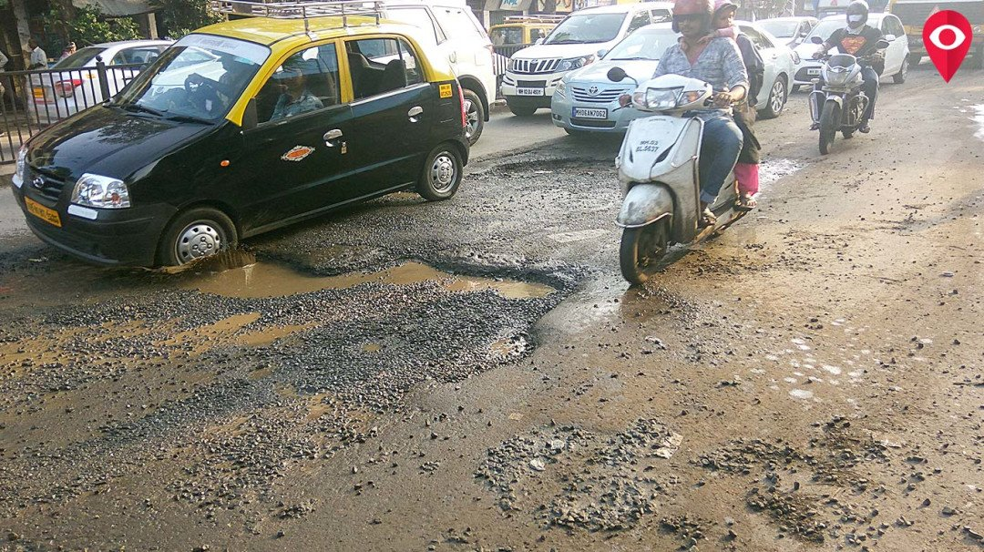 It rains for a couple of days and there are potholes on Dadar streets