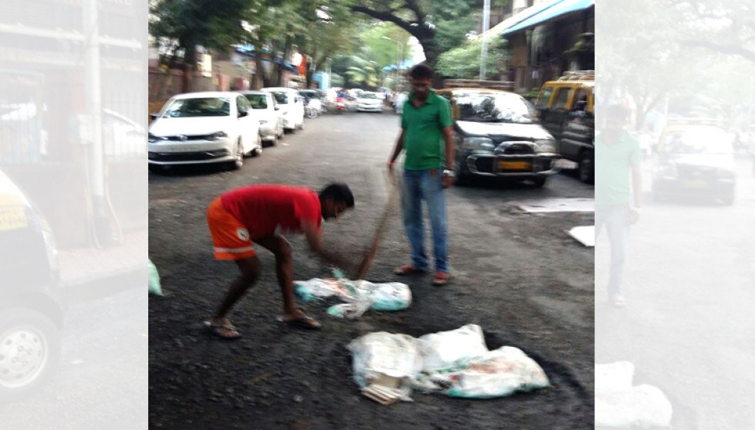 Shiv Sena repairs road