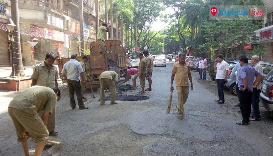 Potholes on Thakur Village roads filled up