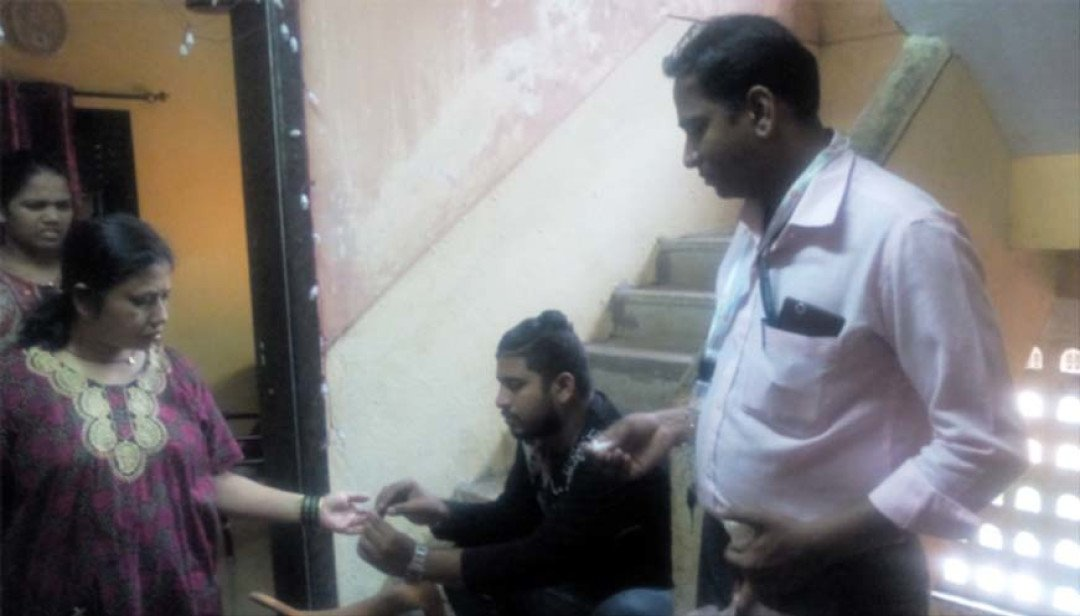 Civic officials examine apartments for dengue