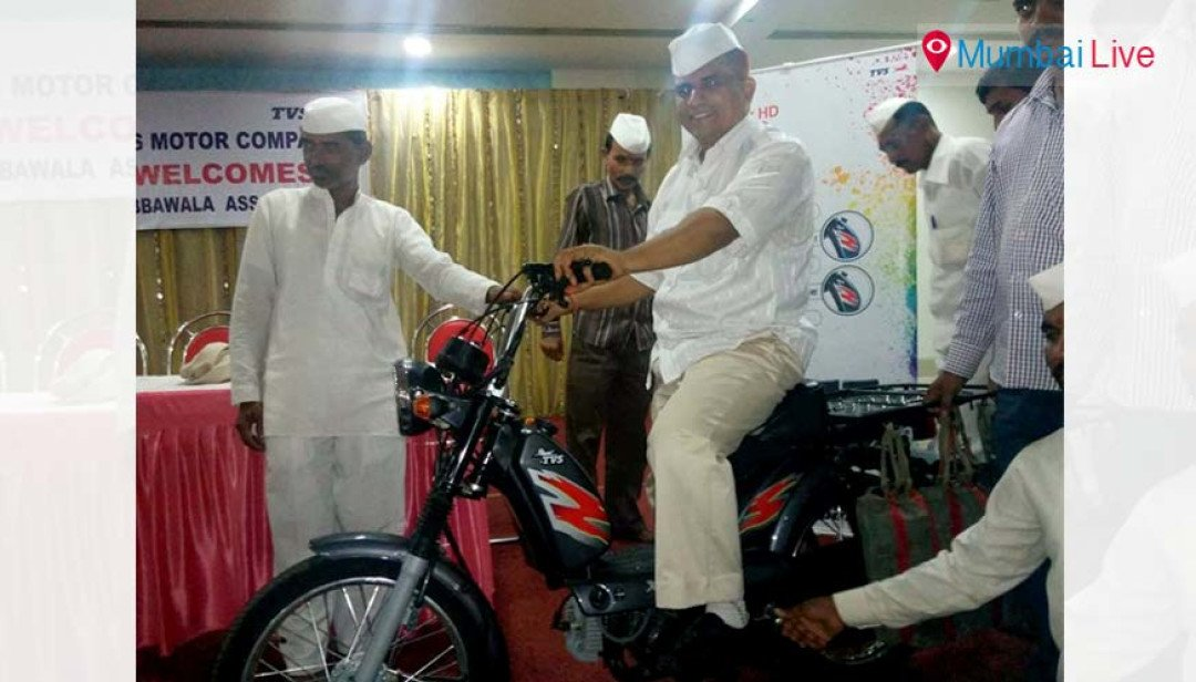 Dabbawalas swap cycles for bikes in Maratha rally