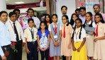 Child artists salute bank officials