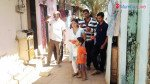 Newly elected Congress Corporator Steffi Keni distributes sweets in her ward